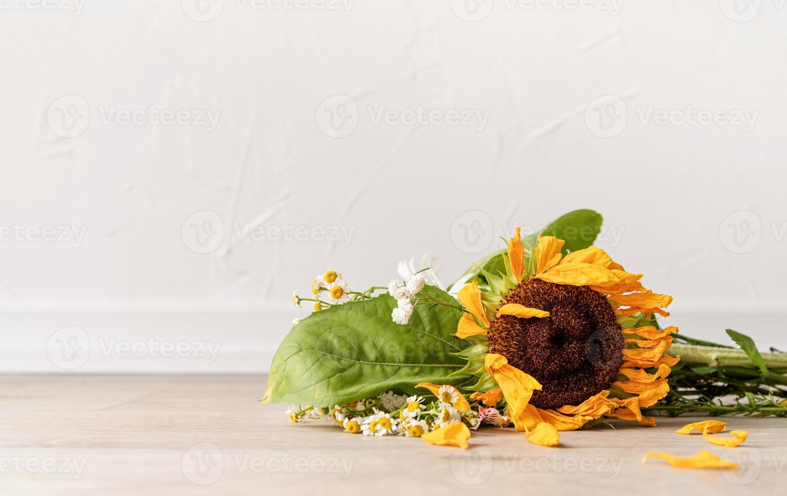 A bouquet of withered flowers on the floor photo