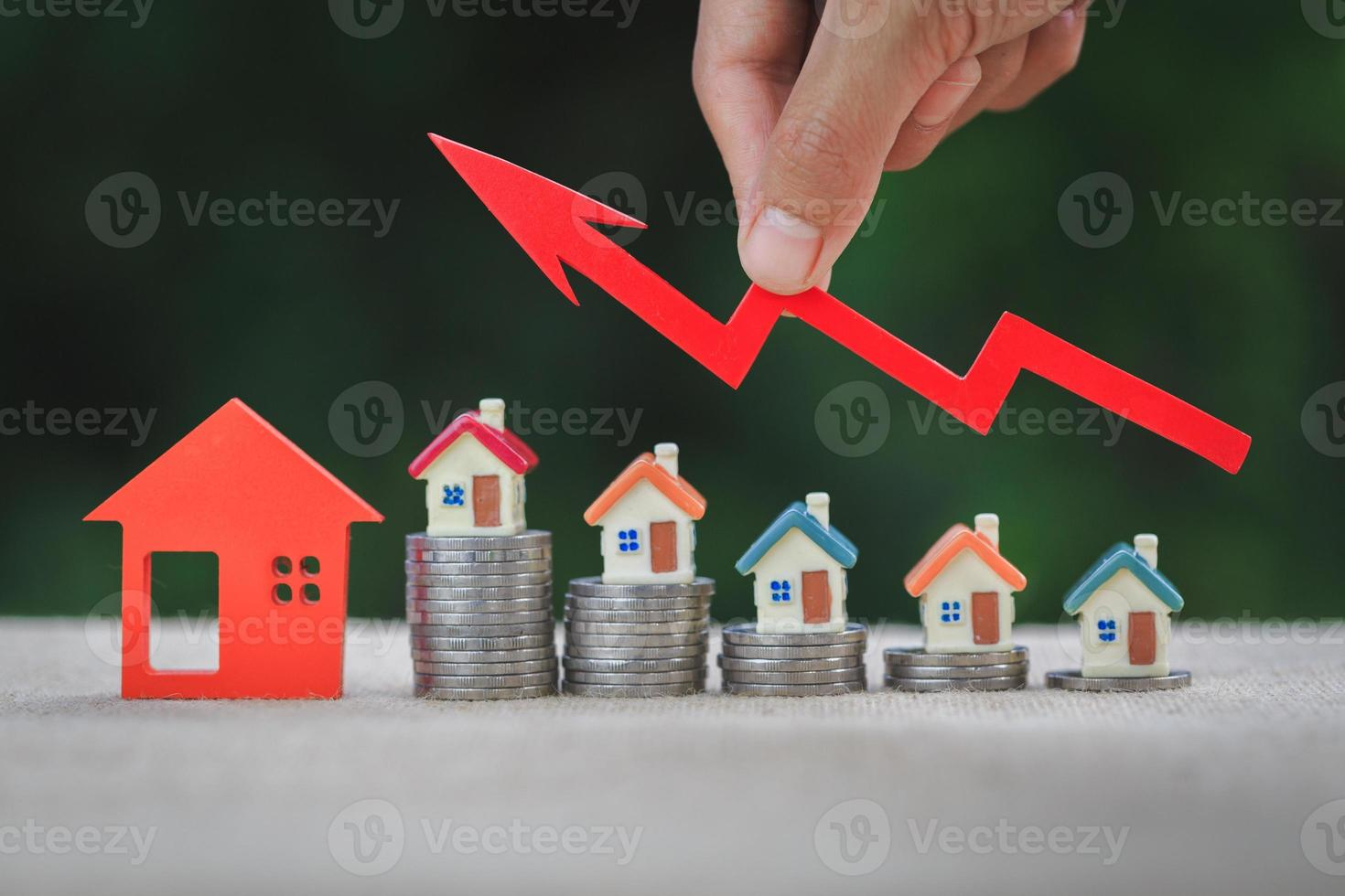 House model and a stack of coins. Real estate market, graph up arrow.  The concept of inflation, economic growth, Property investment. photo
