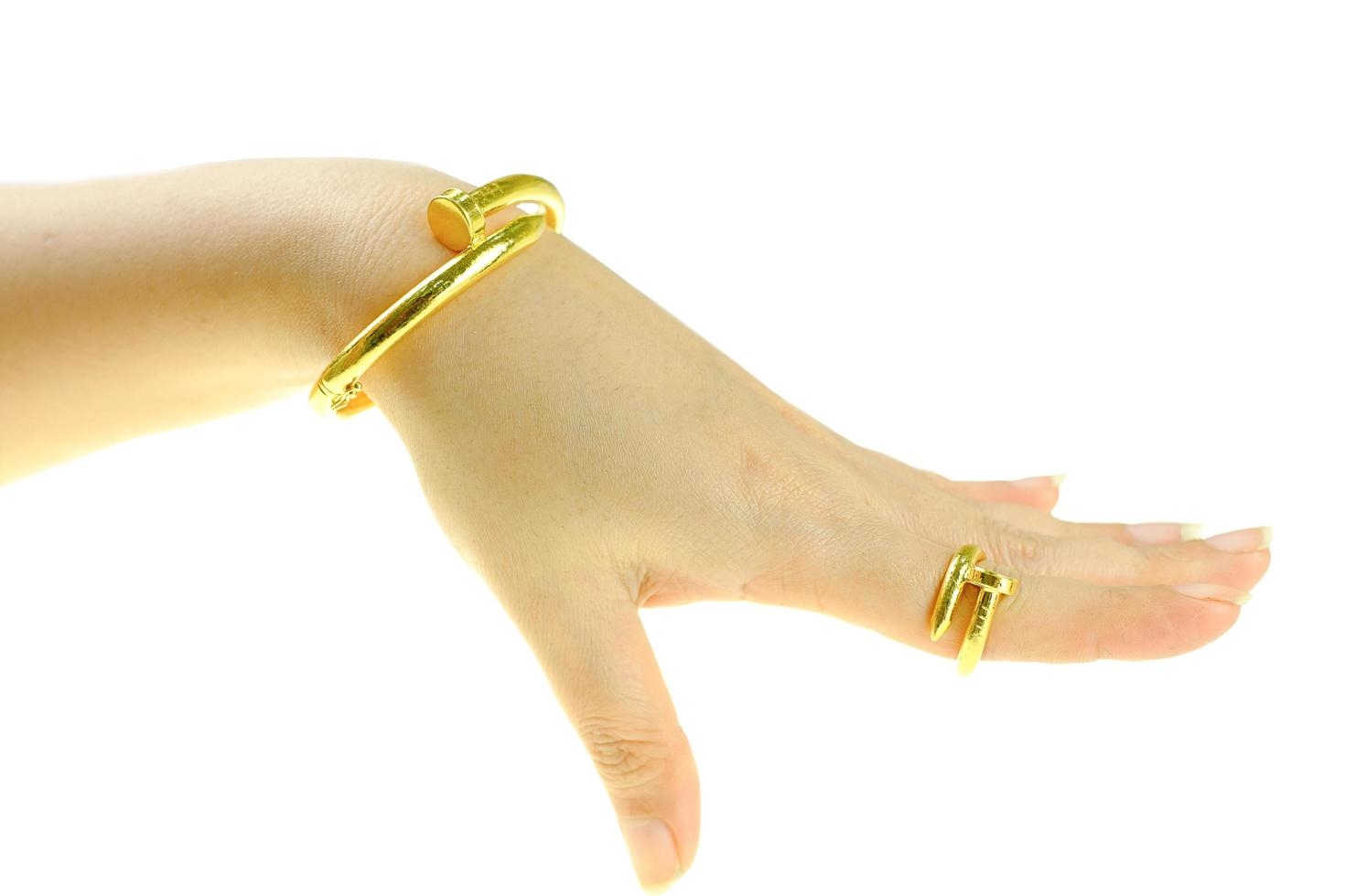 Woman's hand with a gold bracelet and ring jewelry photo