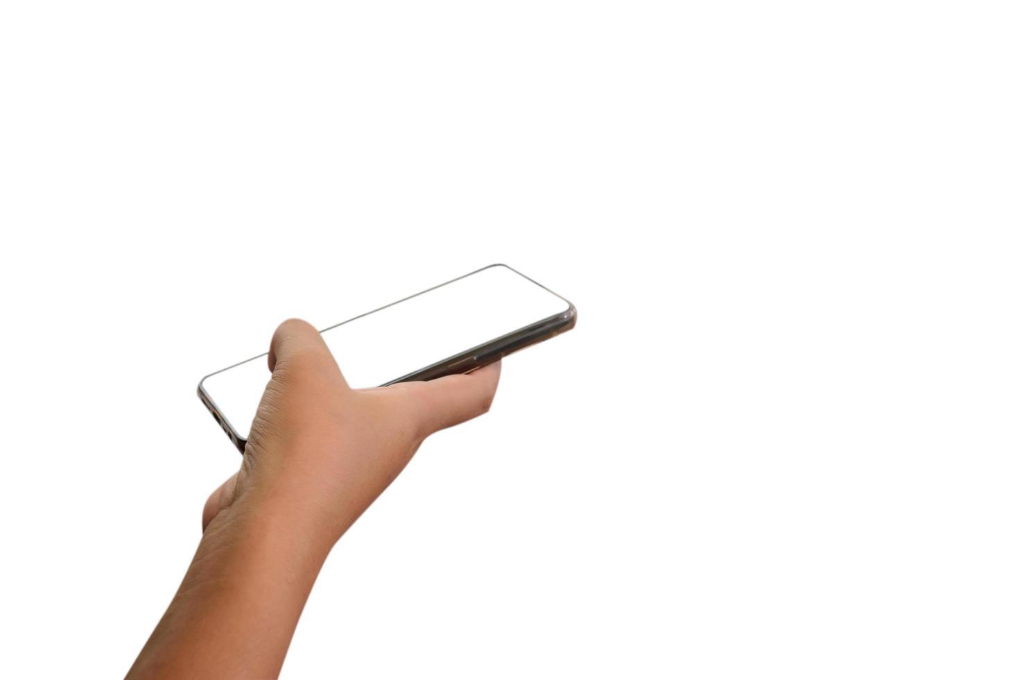 Mano sujetando un teléfono inteligente sobre fondo blanco. foto