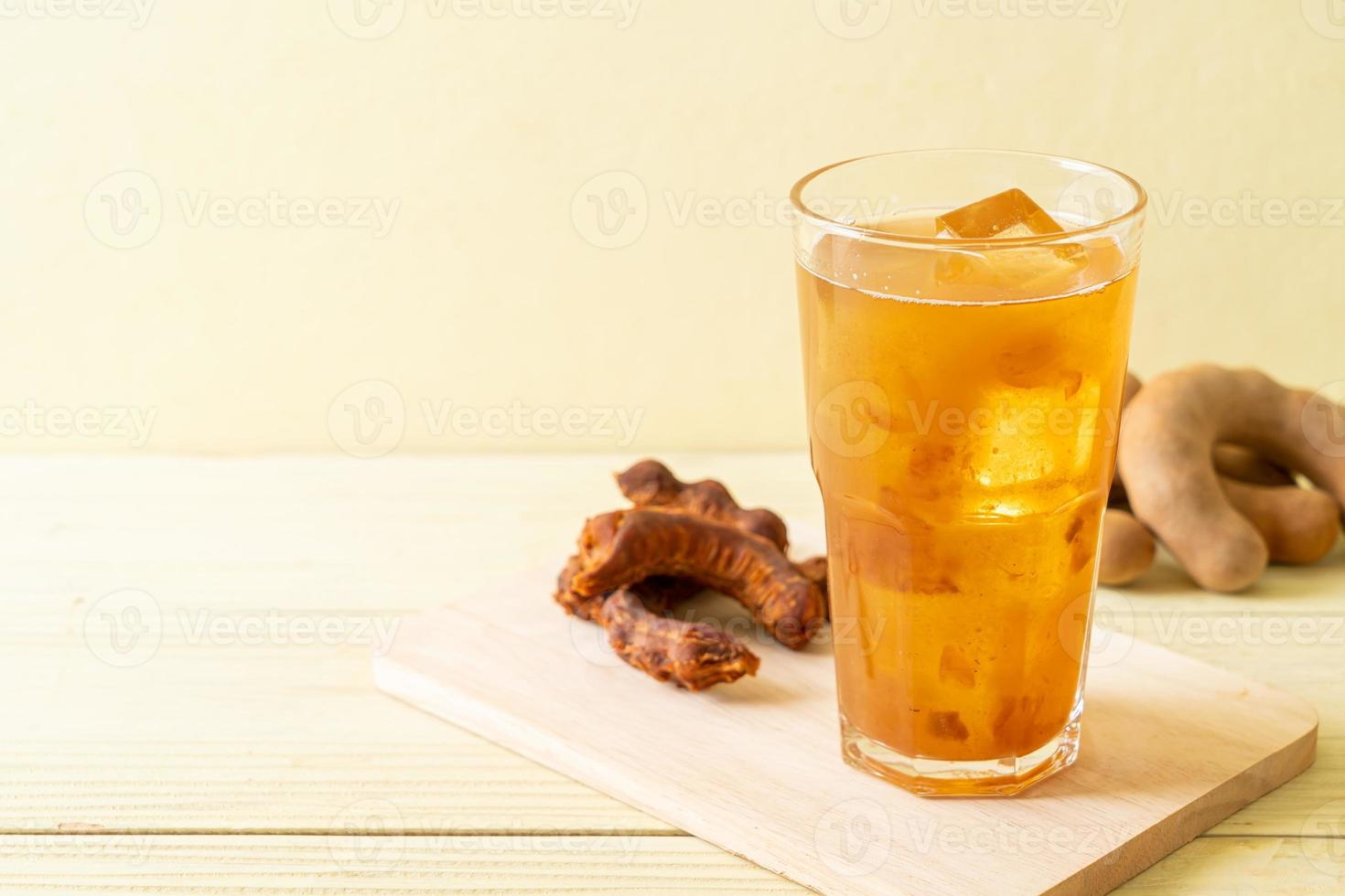 Delicious sweet drink tamarind juice and ice cube photo