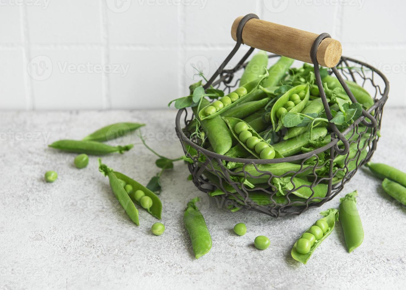 Fresh green peas pods and green peas with sprouts photo