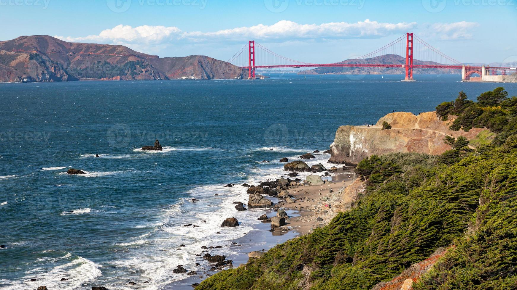 Landscape of Golden Gate bridge over sea horizon from Baker beach. photo