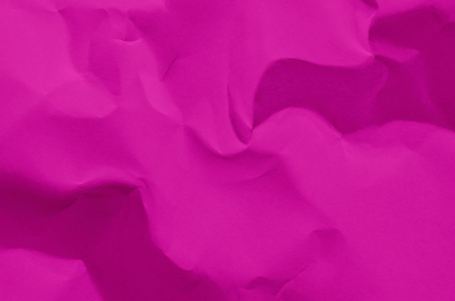 Pink background and wallpaper by crumpled paper texture. photo