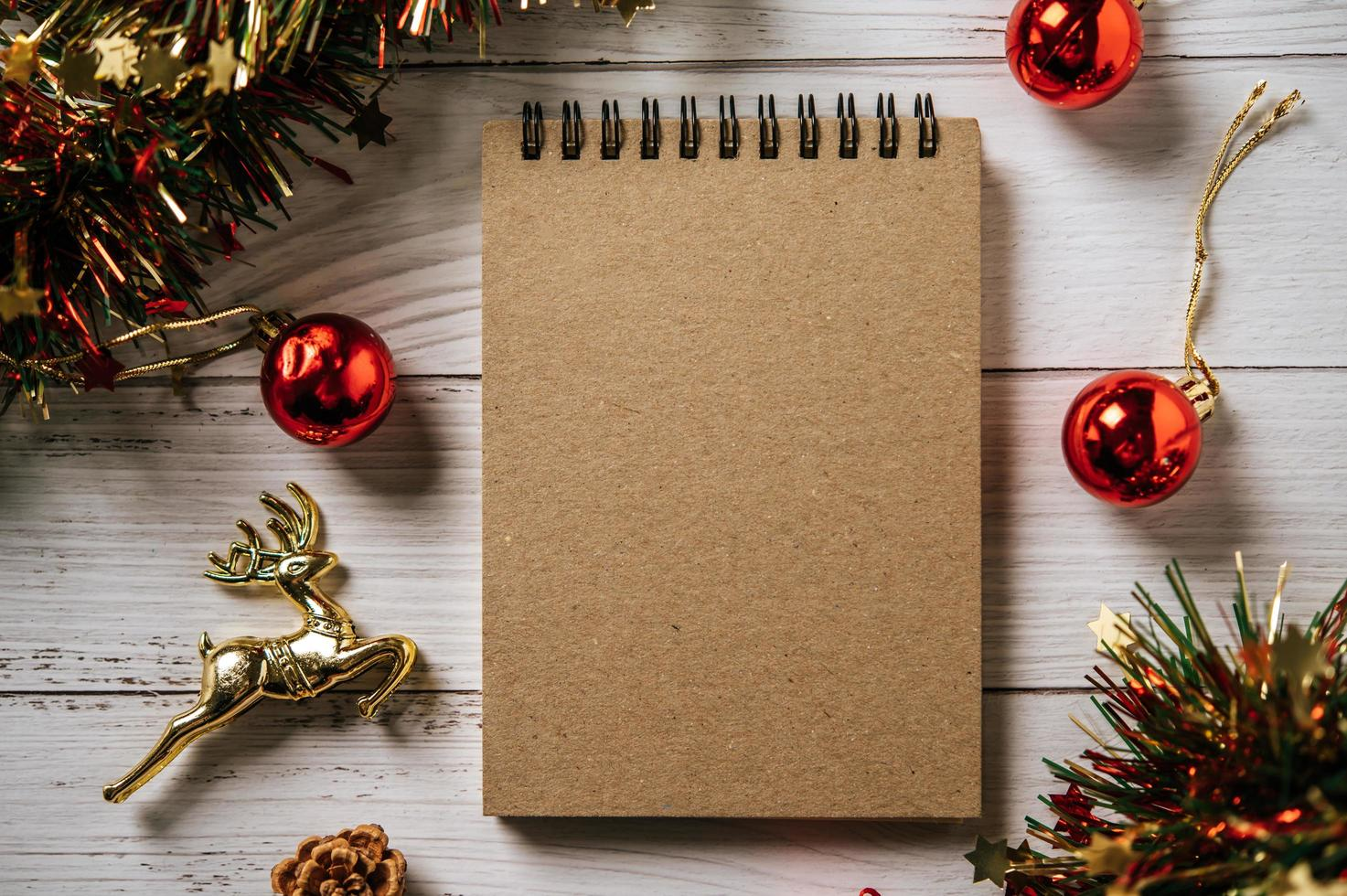 A notebook placed on a wooden background photo