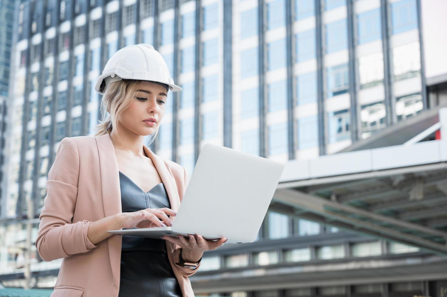Portrait of pretty young civil engineer woman working photo