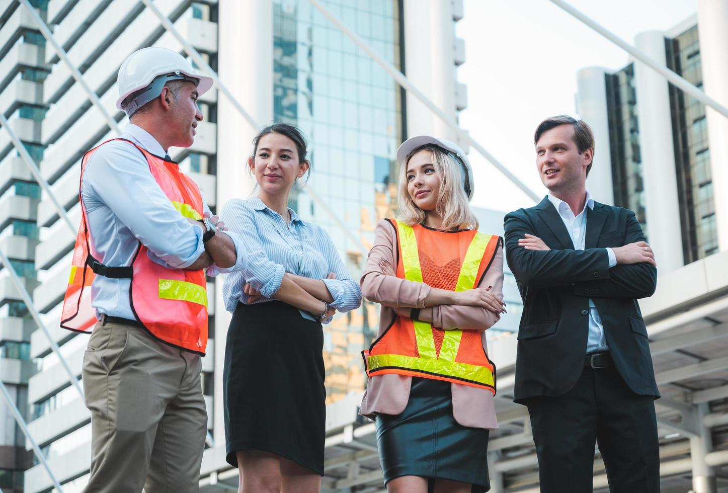 Business man and woman with civil engineer. photo