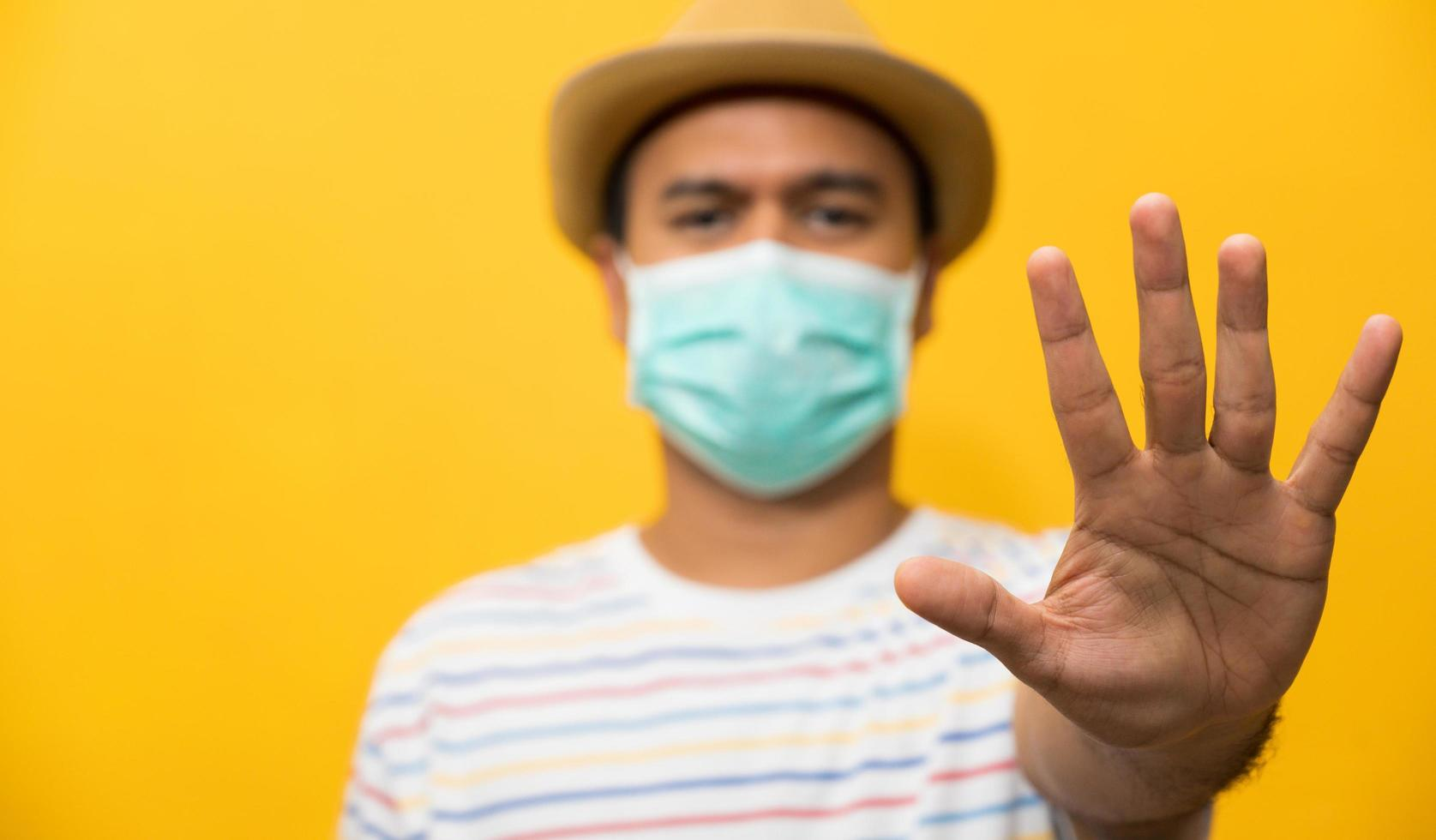 Close up young asian man wearing protection face mask photo