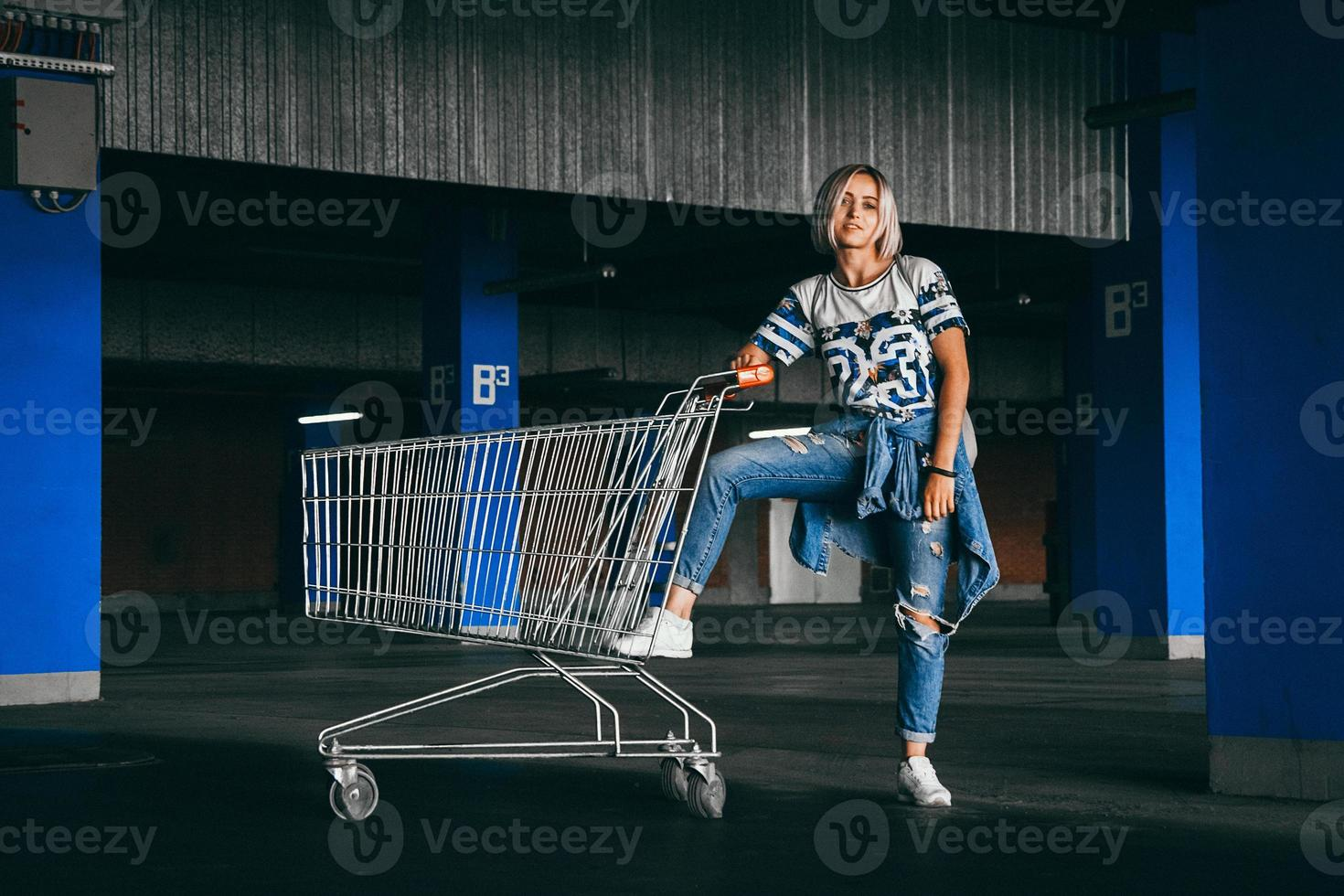 Woman with shopping carts in a parking lot photo