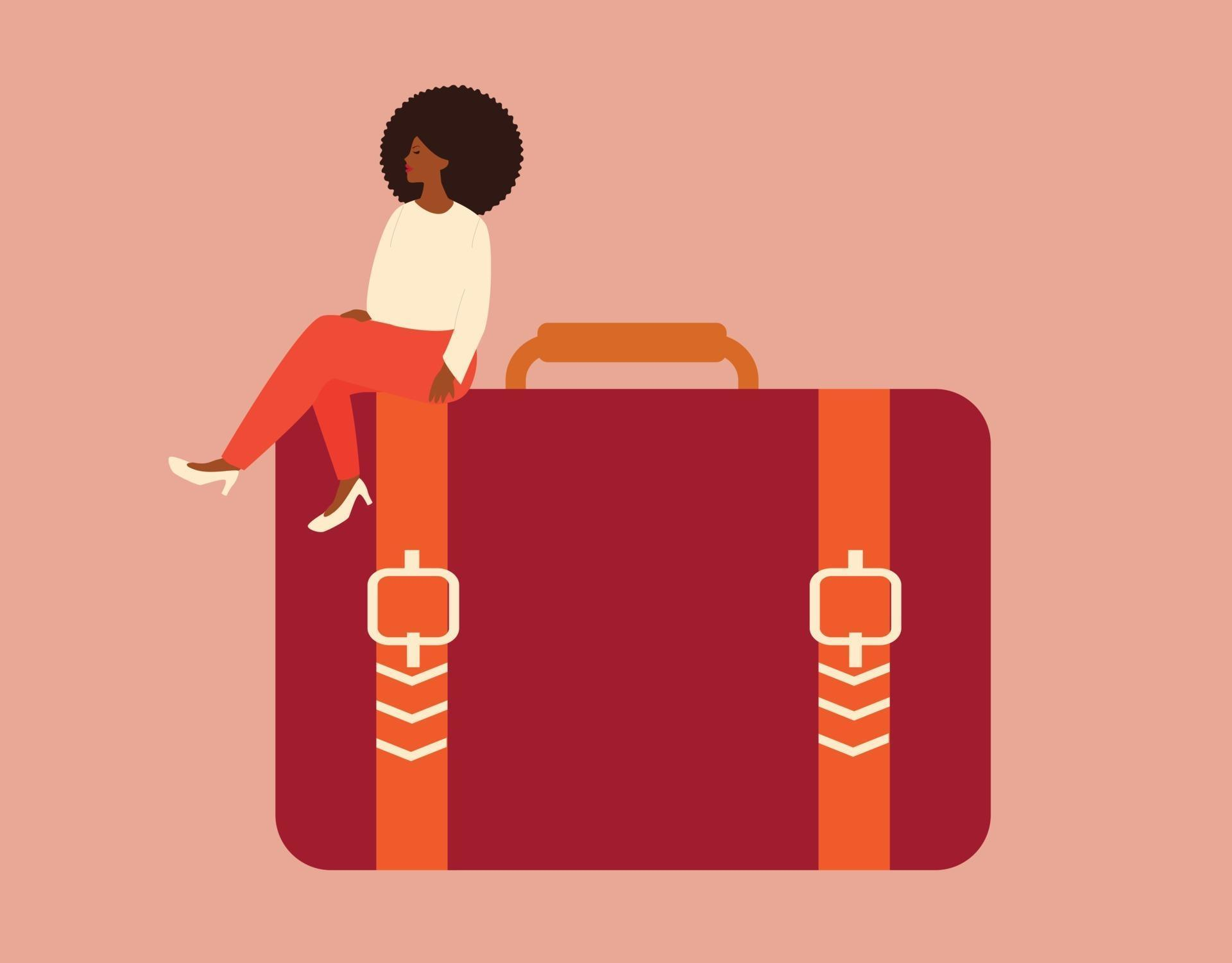 American black woman sits on a big briefcase with