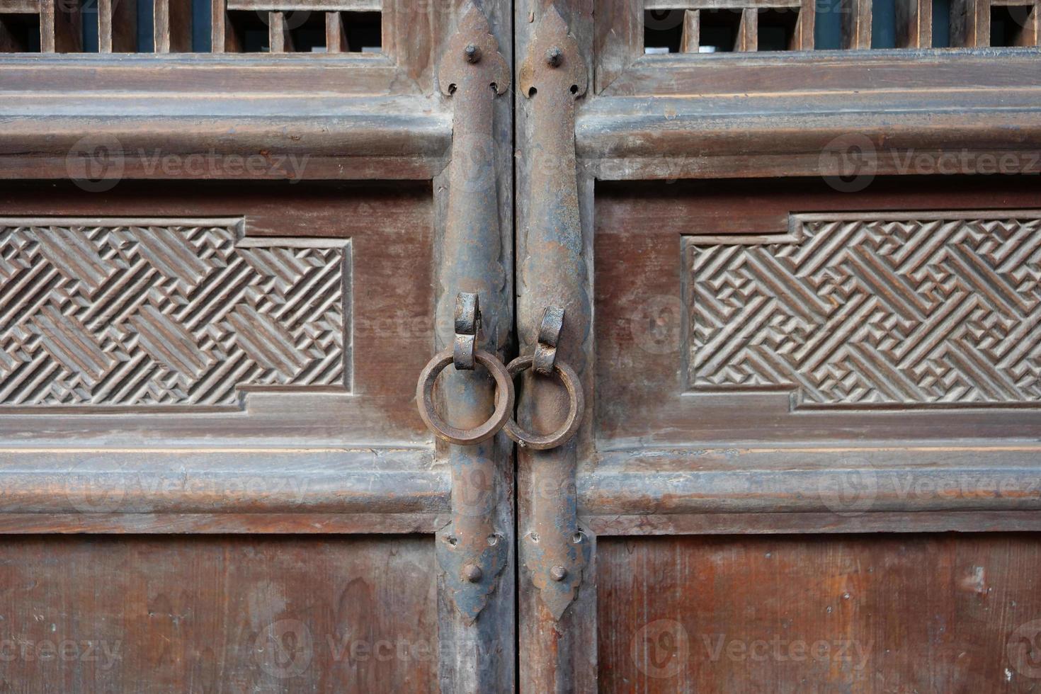wooden door and metal door ring photo