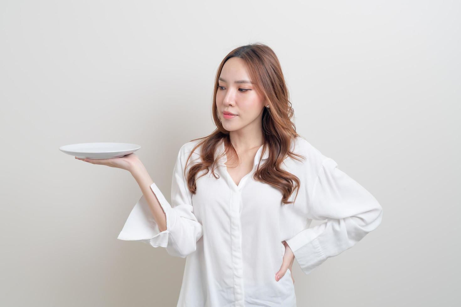 Portrait beautiful Asian woman holding empty plate photo