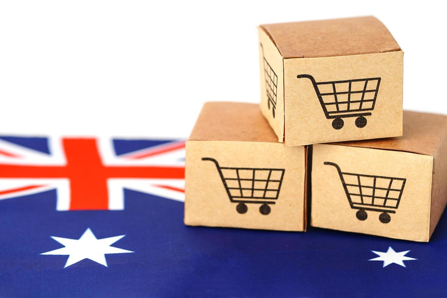 Caja de carrito de compras en la bandera de Australia, importación y exportación foto