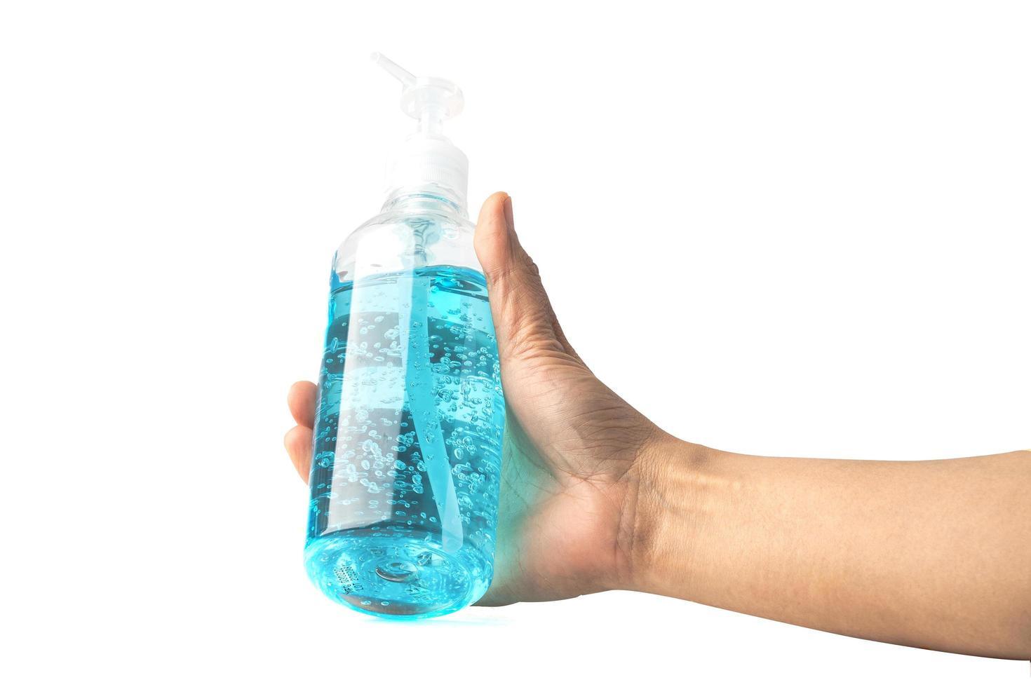 dama asiática sosteniendo gel de alcohol en la mano protege el coronavirus foto