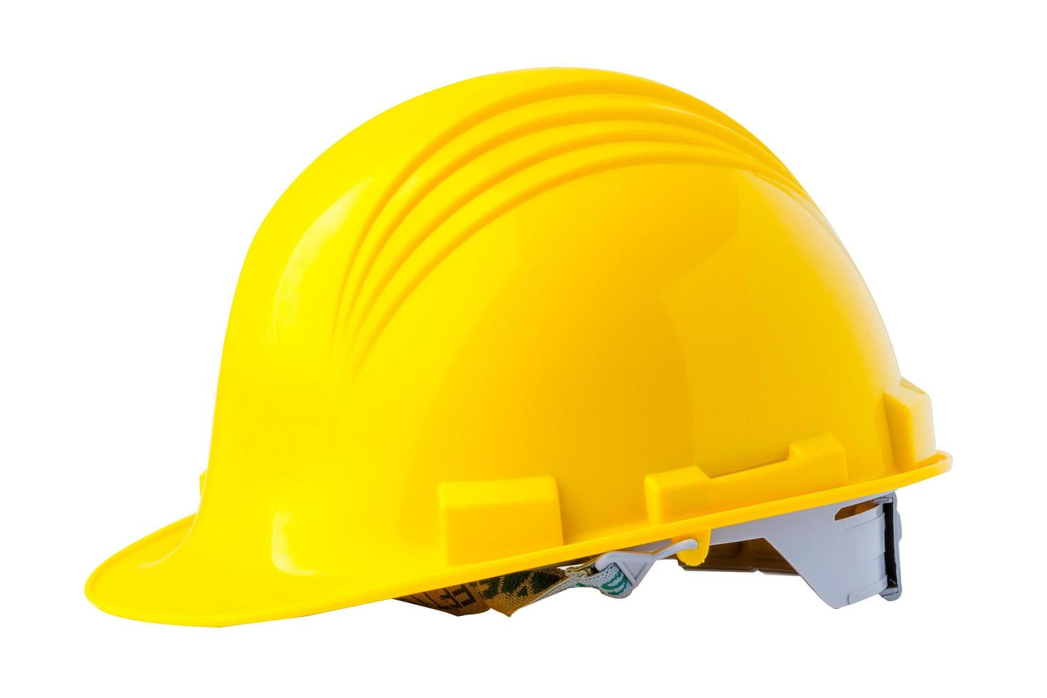 casco de construcción amarillo con plano, concepto de seguridad del ingeniero. foto