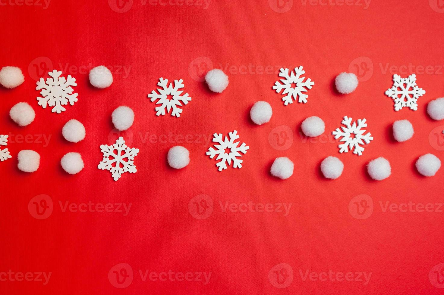 Christmas Happy New Year greeting card with line of snowflakes on red photo