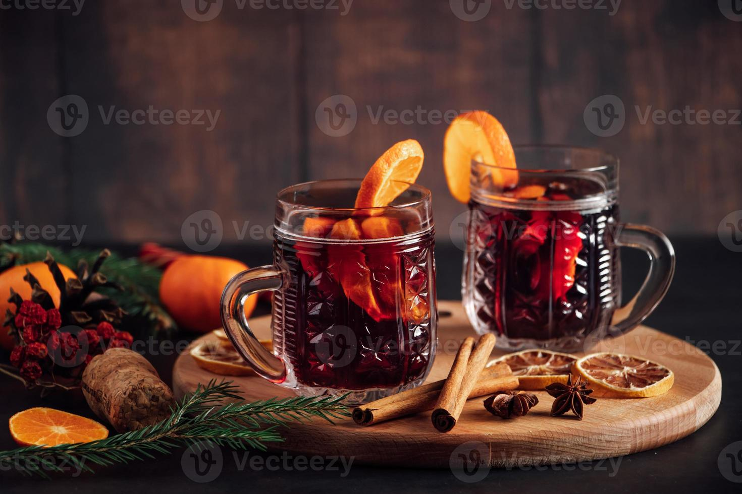 Hot mulled wine in glass cup. Warm winter drink photo