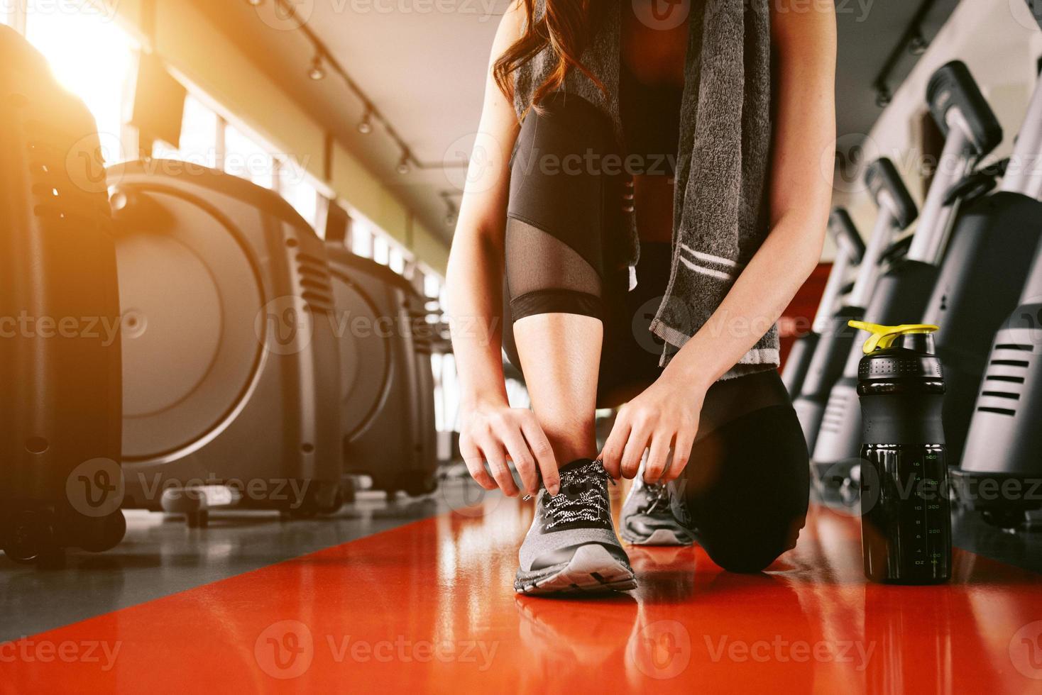 Sport woman tying sneakers rope photo
