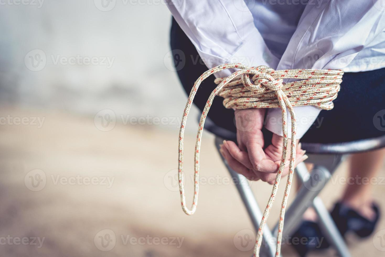 Close up of woman hand with tie rope photo