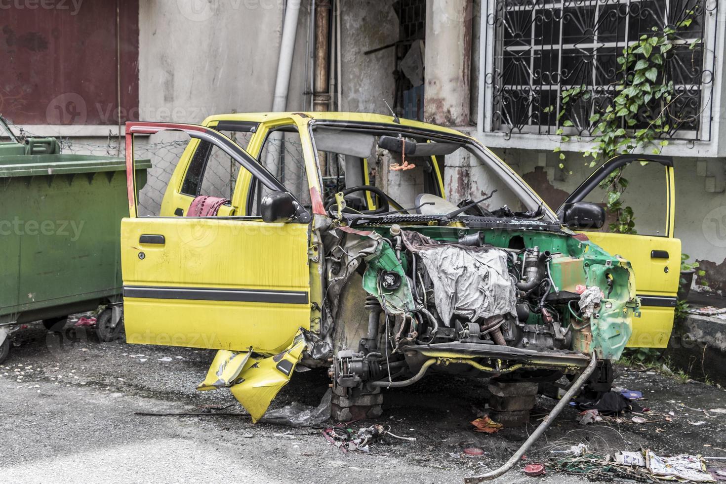 Broken accident car in a housing development in Kuala Lumpur. photo