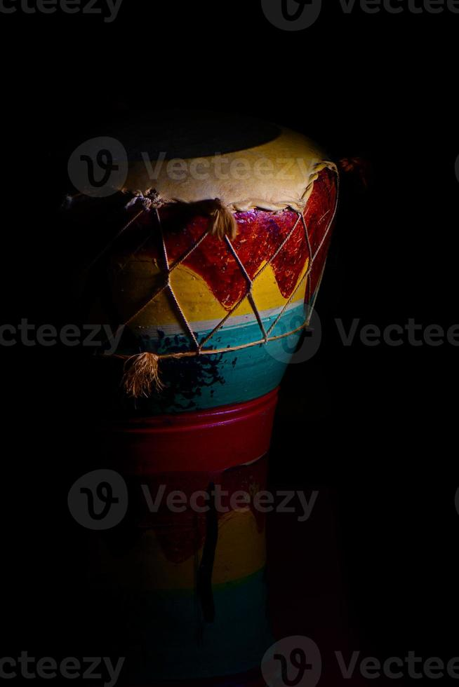 African percussion between lights and shadows on a black background photo
