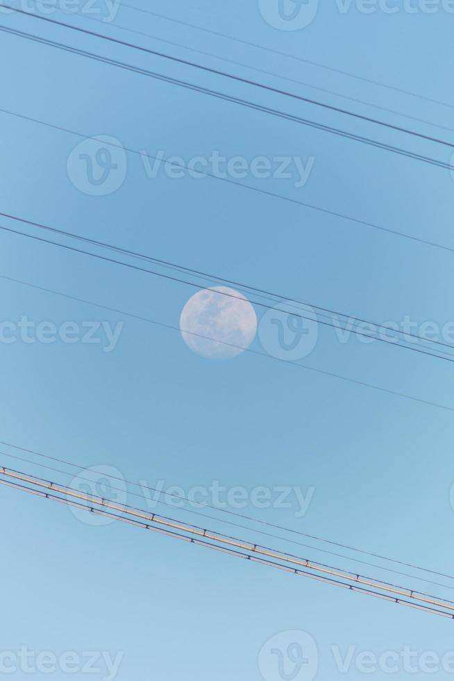 Full moon with the Sugarloaf cable car cables in Rio de Janeiro, Brazil photo