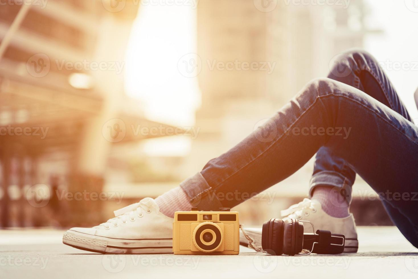 Woman legs wearing jeans and resting and relax in urban photo