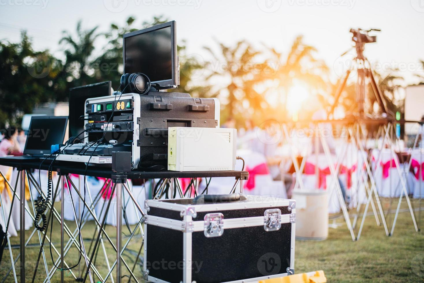 Mixing equalizer at outdoor in music party festival with dinner table photo