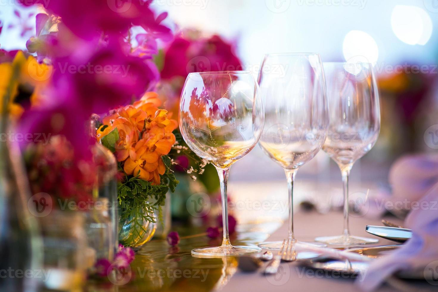 Table setting for a wedding or dinner event, with flowers photo