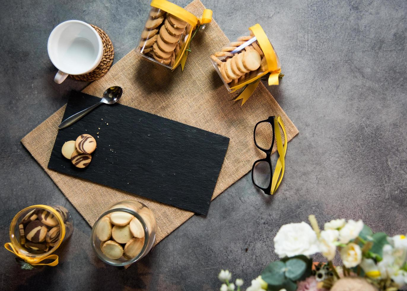 Top view coffee cup with cookies and Black marble photo