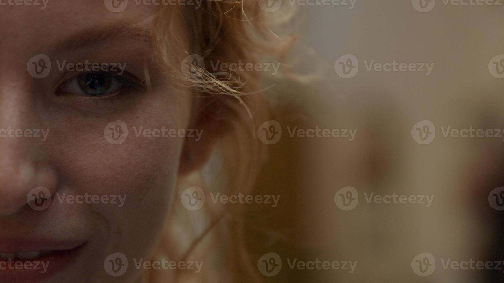 Close up of face of right part of young white woman who laughs photo