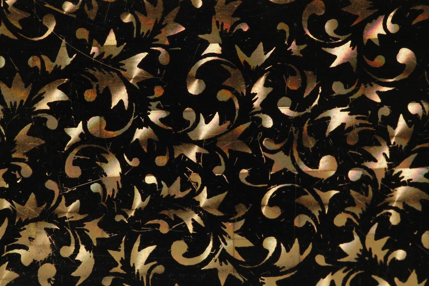 Fondo perlado procesado con pintura especial sobre metal latón. foto