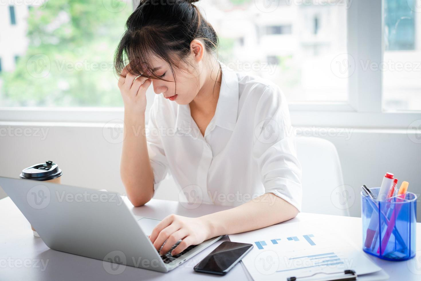 Portrait of a young business woman under pressure and fatigue photo