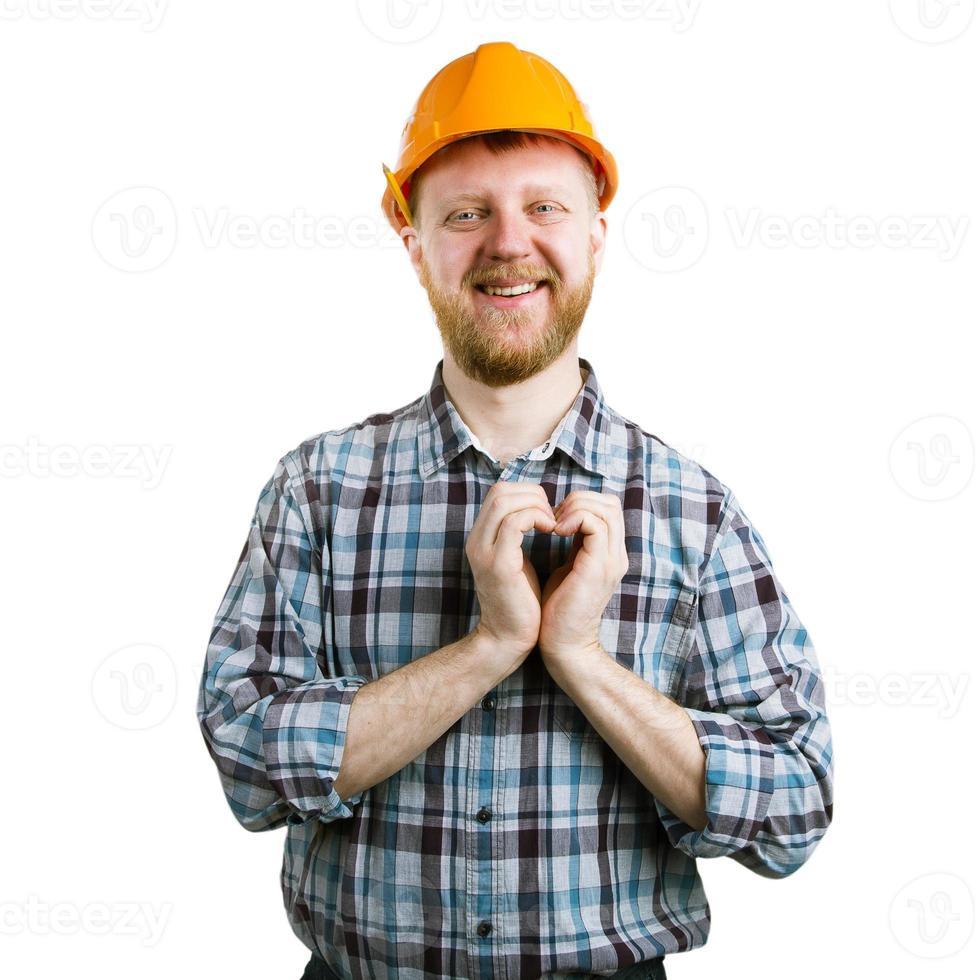 hombre en un casco mostrando manos corazón foto