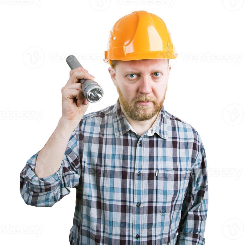 hombre en el casco con una linterna foto