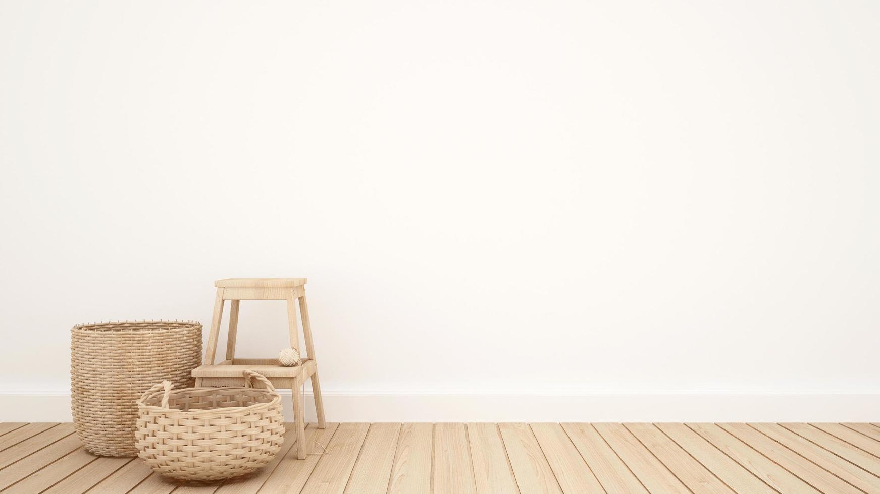 canasta de mimbre y taburete en la sala blanca para obras de arte foto