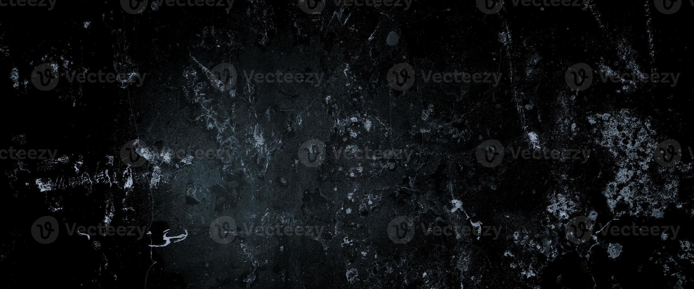 Muros oscuros de miedo, textura de cemento de hormigón negro ligeramente claro para el fondo foto