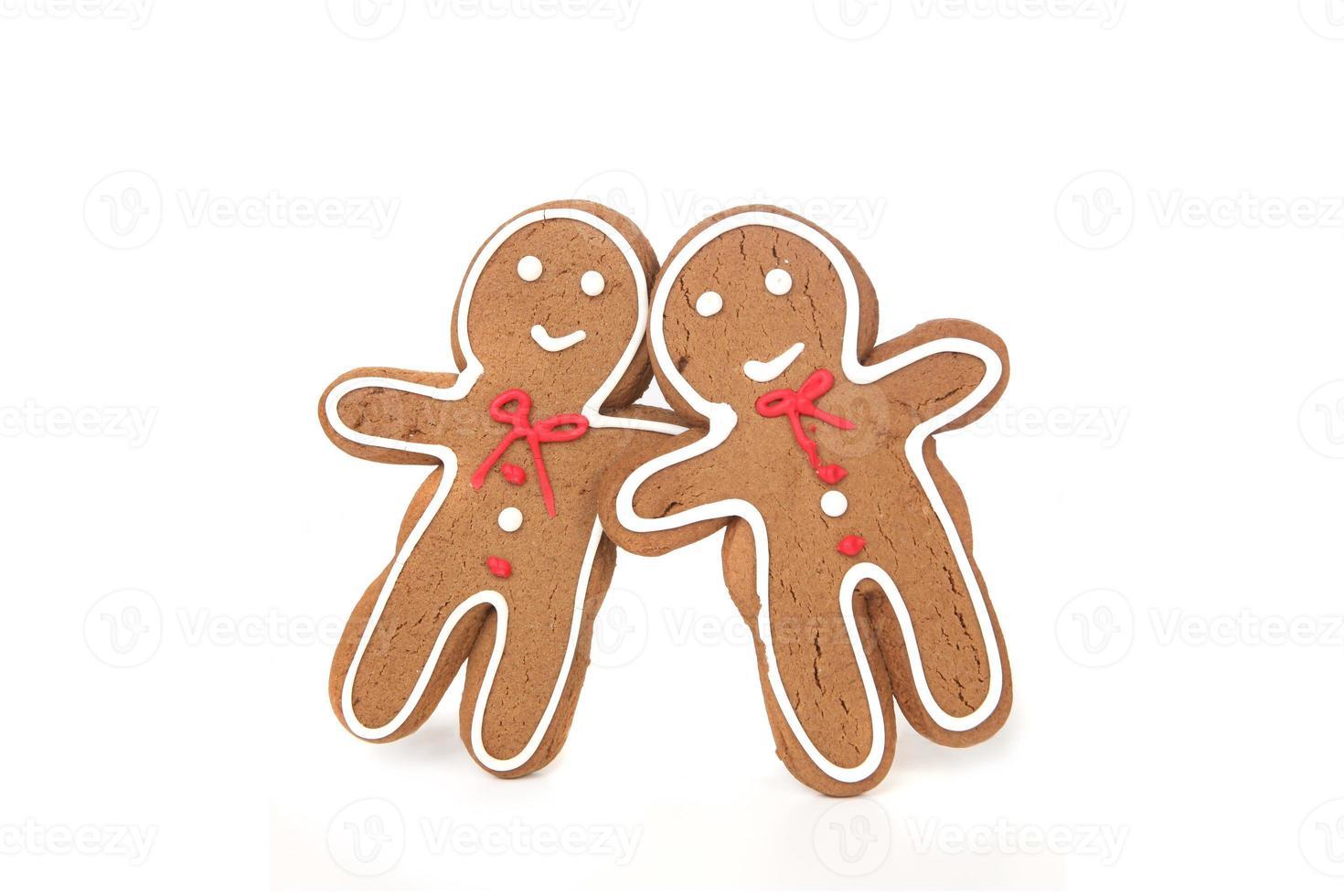 pareja de pan de jengibre apoyado en el uno al otro en el amor foto