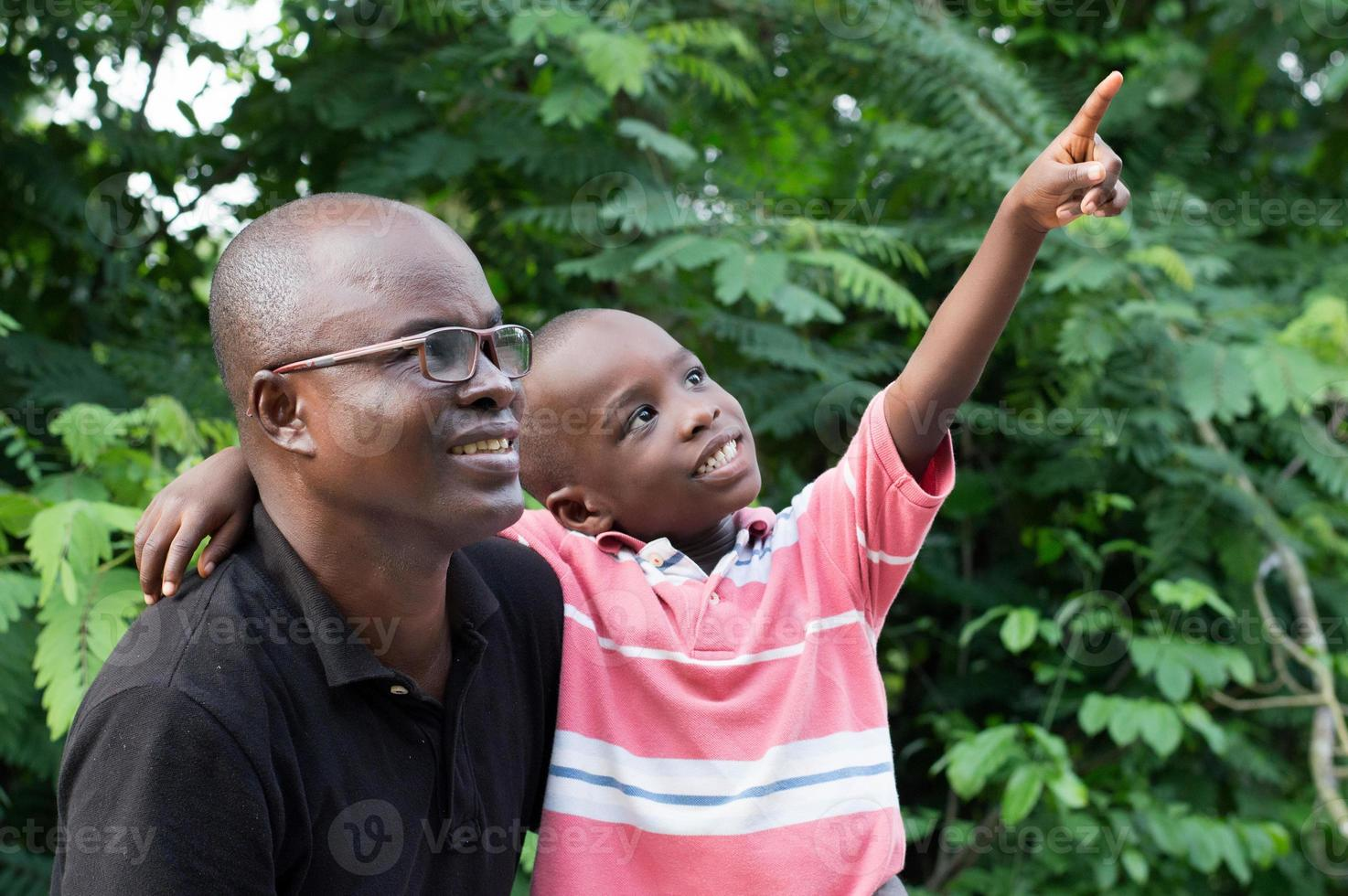 father and son in countryside photo