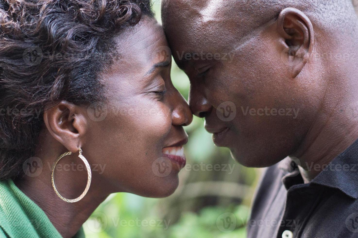 Romantic couple standing face to face and embracing each other photo
