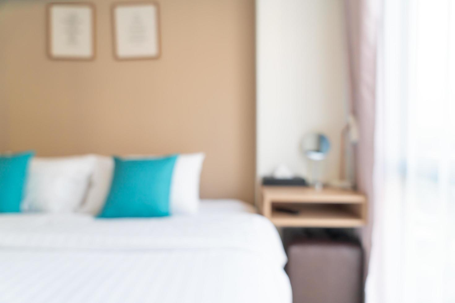 Cama de desenfoque abstracto en el dormitorio de fondo foto