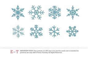 8 copos de nieve dibujados a mano del vector