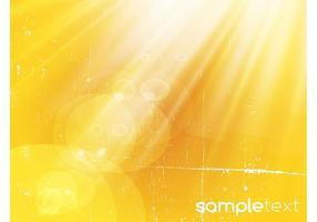 Fondo amarillo de los rayos ligeros