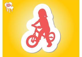 Menina na silhueta da bicicleta