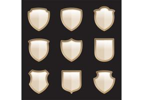 Vecteurs de bouclier héraldique d'or