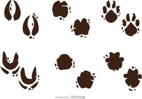 Muddy huellas de los animales vectores