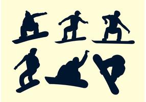 Silhouettes of snowboarders