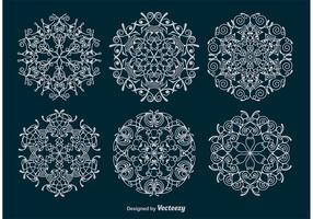 Vectores ornamentales de copos de nieve