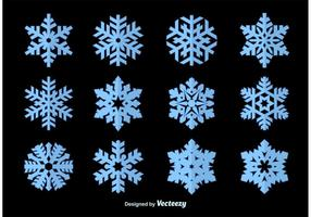 Copos de nieve silueta vectores