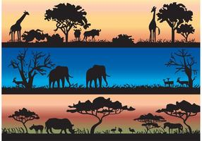 Vector siluetas con animales salvajes africanos y árboles de acacia